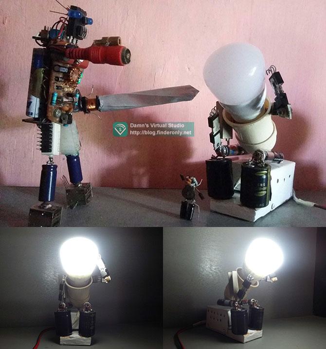 Hiasan robot dari komponen elektronik